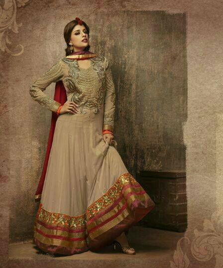 Get ready to grab the attention with this striking Fawn color Churidar Dress that looks great with embroidery patches, Stone, resham, sequins, zari and latken work. Entire combination looks great due its rich colors, embroidery patch work and other works done on it. To add to its beauty a matching Churidar and a beautiful looking Dupatta is provided.