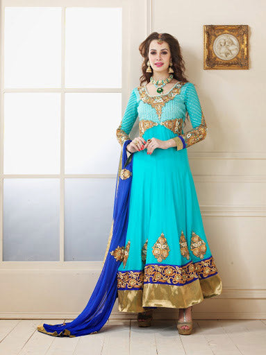 Be at your fashionable best with this cool blue Anarkali suit made of Faux Georgette material. Attractive work is done to enhance the look. The Dress is paired with stylish Dupatta and a churidar Bottom. Beautify it with your preferred style accessory to gain further complements.