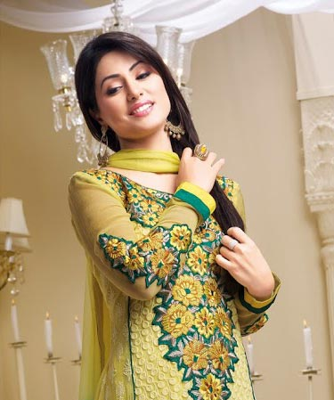 Be the showstopper with this stunning Hina Khan Salwar kameez line-up. This gorgeous dress is created from Yellow and Green Shaded Georgette material. Beautiful Embroidery work is done on the neck and the sleeves. Stylish Lace work is done around the bottom. Stunning yellow churidar and a shaded dupatta completes the look.