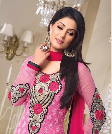 Be the showstopper with this stunning Hina Khan Salwar kameez line-up. This gorgeous dress is created from Pink Georgette material. Beautiful Embroidery work is done on the neck and the sleeves. Stylish Lace work is done around the bottom. Stunning pink churidar and a shaded dupatta completes the look.
