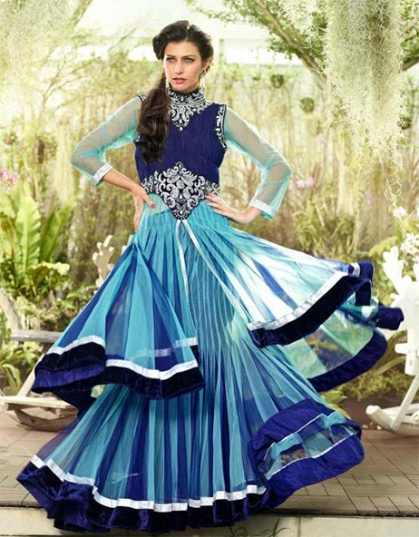 Be at your best this marriage season with this fresh look bridal and wedding collection. This Bridal lehenga choli is made from Aqua Blue & Royal Blue Shaded Net material. Fresh new colors add a new look to this lehenga choli. This 3 piece set is embellished with Zari, resham embroidery & velvet patch border . A designer bordered dupatta completes the look.