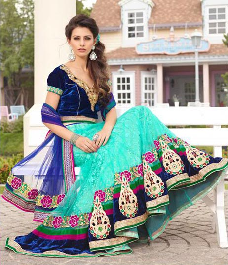 Be at your best this marriage season with this fresh look bridal and wedding collection. This Bridal lehenga choli is made from Aqua Blue Color Net Lehenga with Dark Blue velvet Choli. Fresh new color adds a new look to this lehenga choli. This 3 piece set is embellished with Zari, resham embroidery & a heavy patch border . A designer floral bordered dupatta completes the look.