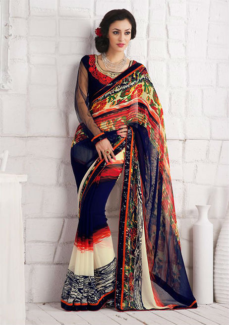Add Style and Elegance to your persona with this beautiful designer Multicolor Faux Georgette Saree with beautiful Print work and a Stunning Blue Art-Silk Blouse. Patch Patta Work adds glamour and zing to this Saree.