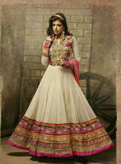 This Stunning Anarkali Churidar Outfit has beautiful embroidery patch work which complements the Resham, Zari, Stone and Latken Work. The Top Portion looks great with nice embroidery and Contrast patches. The neck cut is also tempting and beautiful. To add to its beauty a matching Churidar and a Dupatta is provided. Entire combination looks great and makes superb wear.