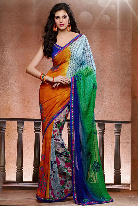Add Style and Glamour to your look with this attractive Orange and Green Designer Georgette Saree. Beautiful Zari and Resham embroidery with Stone work and Patch Patta work adds glamour to this designer sari. Beautiful Blue Color Georgette material Blouse is provided.