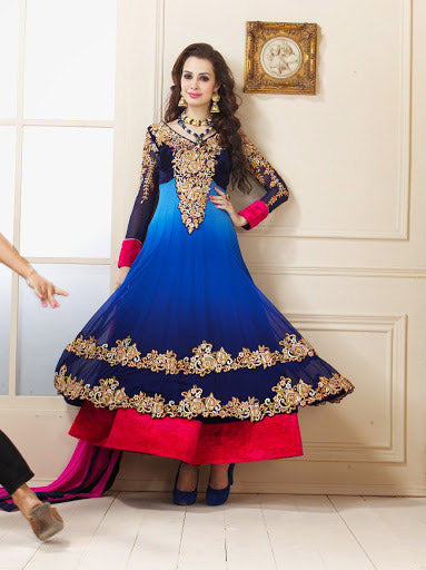 Be at your fashionable best with this Pleasing Purple Anarkali suit made of Faux Georgette material. Attractive work is done to enhance the look. The Dress is paired with stylish Dupatta and a churidar Bottom. Beautify it with your preferred style accessory to gain further complements.