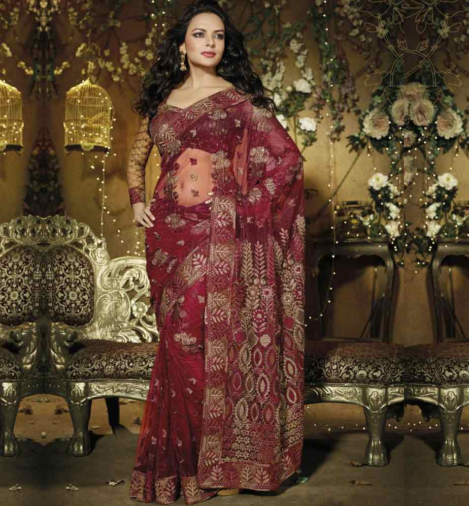 Be the Eye-Candy with this striking Saree crafted beautifully from Maroon Net material. Amazing Sequence, Zari embroidery and Patch Patta Work adds glamour and style to this sari. Beautiful Maroon Net material Blouse (with Inner) is provided to make it drop deadly.