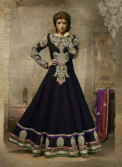 Be the center of attraction with this full length Black royal look georgette Anarkali suit. With contrast embroidery patches on the neck and sleeves and resham, zari, sequins, stone and latken work this dress looks absolute stunner. Entire combination looks great due its rich colors, embroidery patch work and other works done on it. To add to its beauty a matching Churidar and a beautiful looking Dupatta is provided.