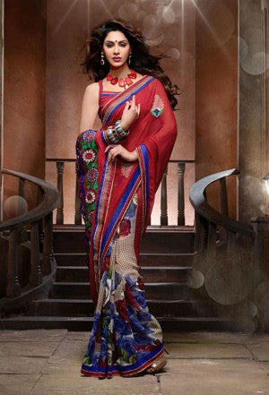 Add Style and Glamour to your look with this attractive Maroon and Blue Designer Chiffon Saree. Beautiful Zari and Resham embroidery with Stone work and Patch Patta work adds glamour to this designer sari. Beautiful Maroon Color Chiffon material Blouse is provided.