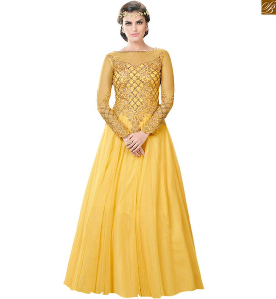 Image Of Long gowns dress online india special occasion wear for girls yellow net boat type embroidered neck designs with embroidered long sleeve gown and beautiful stone work