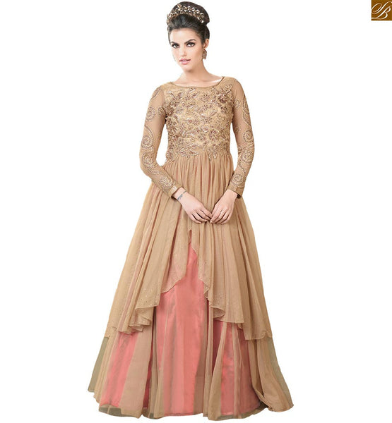 Trendy & Crafty embroidery plus stoned on upper part, Boat Neck, Back & sleeves Beige Net Gown Latest evening gowns collection of elegant dresses best collection