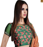 STYLISH BAZAAR PRESENTS APEALLING ORANGE AND GREEN SARI CONJUGATED TO A GREEN BLOUSE RTROS10006