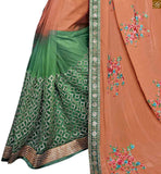 A STYLISH BAZAAR PRESENTATION APEALLING ORANGE AND GREEN SARI CONJUGATED TO A GREEN BLOUSE RTROS10006