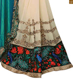 FROM THE HOUSE  OF STYLISH BAZAAR BEWITTCHING SKY BLUE AND CREAM SAREE UNITED TO A BLACK AND CREAM  BLOUSE RTROS10007