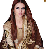 A STYLISH BAZAAR PRESENTATION PLEASING COFFEE AND CREAM SARI MATCHED WITH A CREAM BLOOUSE RTROS10011