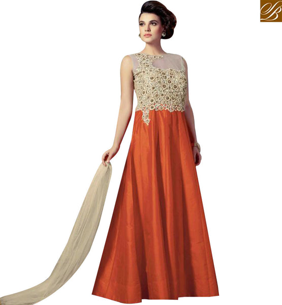 STYLISH BAZAAR BEAUTIFUL ORANGE SILK DESIGNER GOWN HAVING RESHAM EMBROIDERY WORK ON THE CHEST AREA SLMKT1001