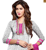 Latest punjabi suit designs of glamorous salwar kameez 2015 are unique in their color combination and design. A perfect casual dress for women to wear at work and home for ultimate comfort off-white chanderi-cotton high neck designer dress with floral embroidery patch work on neck line Photo