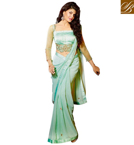 JACQUELINE FERNANDEZ CELEBRITY IN CUTE BLOUSE DESIGNS AND SARI INDIAN DRESS UNIQUE RAMA COLOR GEORGETTE FABRIC PARTY WEAR SAREE WITH RAMA SATIN AND NET FABRIC DESINGER BLOUSE