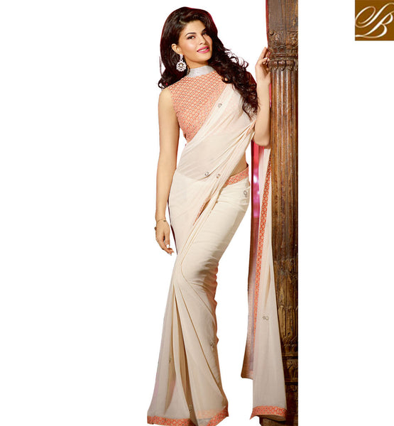 JACQUELINE FERNANDEZ IN DESIGNER BLOUSE DESIGNS WITH CELEBRITY SAREES IMPRESSIVE PEACH GEORGETTE FABRIC PARTY WEAR SAREE WITH PEACH JACQUARD AND NET DESIGNER BLOUSE
