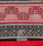 Embroidery work patta and border work on lower part. Red churidar bottom and matching nazneen dupatta with lace border Image