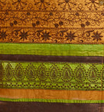 Beautiful green and brown patch work at neck side and border work on lower part. Brown santoon churidar bottom and matching nazneen dupatta with lace border Pic