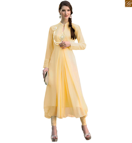 Kurti neck designs stylish attire suitable to wear with leggings cream pure viscose georgette different style long sleeves on kurti with high neck style Image