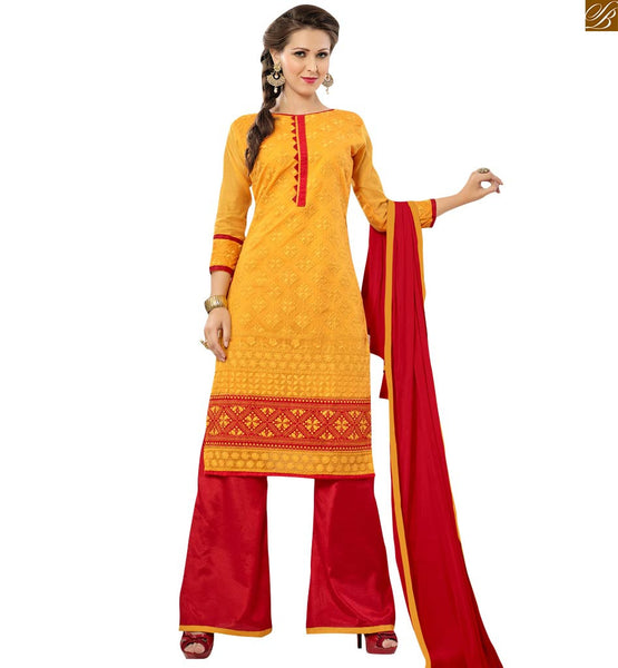 Yellow colored straight cut suit made of chanderi fabric yellow chanderi full floral embroidered salwar kameez with red border work on lower part Image