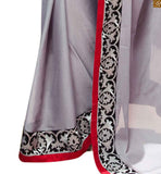 DESIGNER GREY CREPE-SATIN PARTY WEAR SAREE WITH RED AND BLACK  LACE BORDER PAIRED WITH  BLACK VELVET DESIGNER BLOUSE