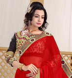 RED FAUX GEORGETTE SARI WITH BLACK DESIGNER DUPION BLOUSE GOOD LOOKING ZARI WORK AND EMBROIDERY DESIGNING IS DONE ON THE CHOLI AND FINE LACE BORDER INCREASES THE LOOK