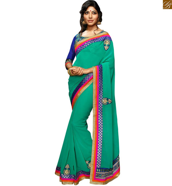 FROM THE HOUSE  OF STYLISH BAZAAR WONDERFUL GREEN SARI COMPLEMENTED WITH A BLUE DESIGNER BLOUSE RTSWA11805