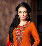 ORANGE DESIGNER GEORGETTE SUIT WITH MATCHING SANTOON SALWAR AND CONTRAST PURE CHIFFON DUPATTA EVE-CATCHING STRAIGHT CUT PARTY WEAR SUIT WITH DETAILING ON THE NECK, BACK AND SLEEVES