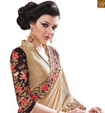 STUNNING BEIGE LYCRA DESIGNER SAREE HAVING WELL EMBROIDERY ON BORDER AND BLOUSE SLEEVES MANJ12108