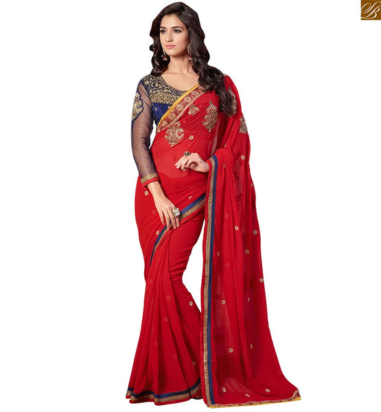 Designer red colored georgette saree with blue velvet net blouse red georgette heavy embroidered designer saree with lace border and blue velvet-net long sleeve blouse Image