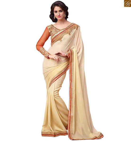 Designer saree of cream color with orange net sleeves cream designer georgette saree with orange long sleeves with cream and orange embroidered kerry butta worked blouse Image