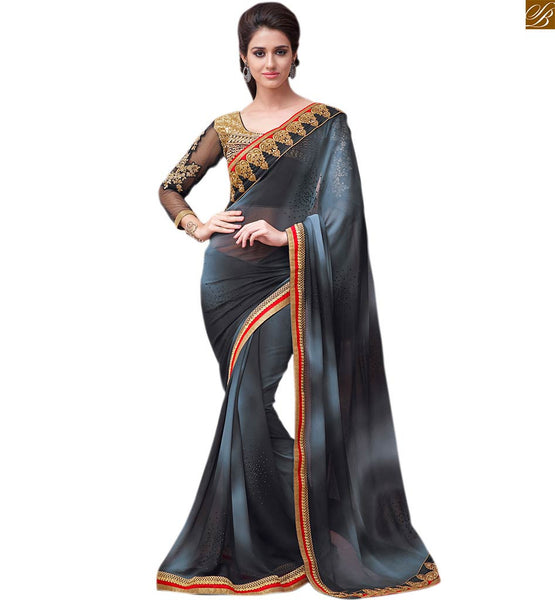 Shaded grey colored designer saree with black blouse grey colored shaded saree with matching black blouse. The embroidery is done on the blouse as well sleeves Image