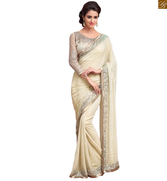 Princess look cream colored designer georgette saree cream georgette heavy sequence worked designer saree with lace border and embroidered designer blouse  Image