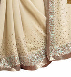 Princess look cream colored designer georgette saree cream georgette heavy sequence worked designer saree with lace border and embroidered designer blouse Pic