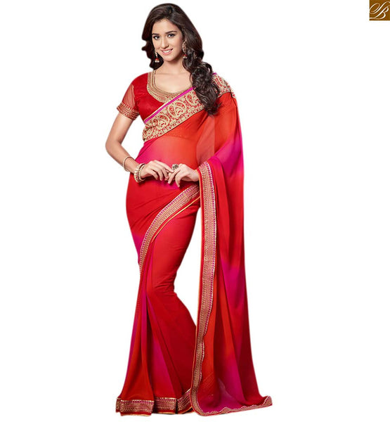 Gorgeous red colored designer saree with heavy embroidery red georgette zari embroidered saree with pink shades and with lace border and red art-silk zari worked blouse Pic