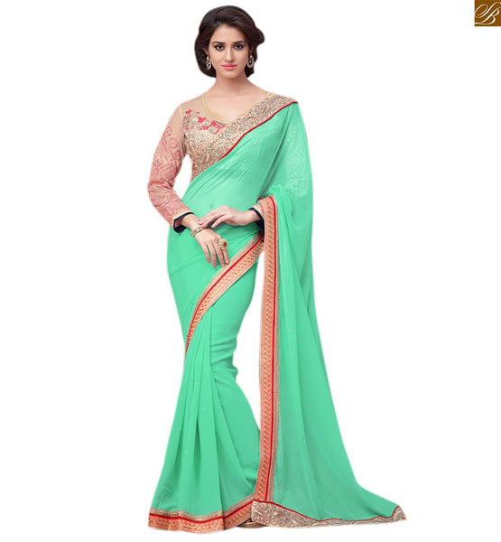 Sea green colored georgette designer sari with cream blouse sea-green georgette heavy embroidered saree with stone work and cream net embroidered blouse Pic