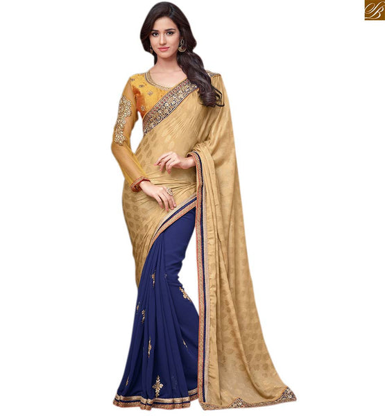 Blue and cream designer party wear saree with orange blouse blue and cream georgette heavy embroidery and zari worked saree with orange blouse made of net Pic