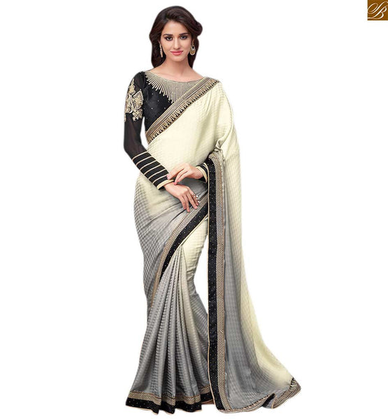 Shaded cream and grey designer saree with black net blouse grey and cream jacquard heavy embroidered saree with stone work and black blouse made of net with long sleeves Pic