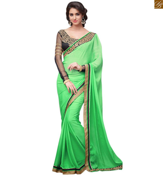 Green designer chiffon sari with black embroiderd blouse green chiffon embroidered heavy saree with lace border work. The black blouse is made of art silk Image