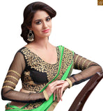 Green chiffon embroidered heavy saree with lace border work. The black blouse is made of art silk. Embroidered long sleeves and neck link are og golden color to make it look rich Pic