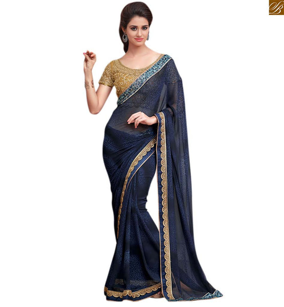 Designer blue saree with beige heavy embroidered blouse blue georgette heavy zari embroidered saree with sequince lace border. The blouse is made of art-silk and is of beige color Image