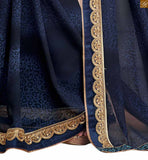 Blue georgette heavy zari embroidered saree with sequince lace border. The blouse is made of Art-Silk and is of beige color. The blouse has heavy zari embroidery work pic