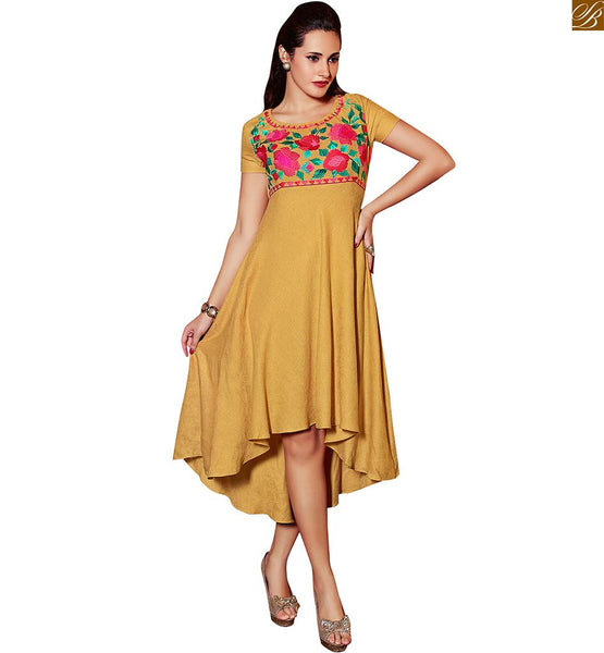 RAVISHING PURE LINEN FLARED AND HIGH LOW LENGTH PAKISTANI LONG KURTI WITH CUTE LOOKING SHAPE  SMART LOOKING KOTI STYLE PINK & GREEN FLORAL EMBROIDERY AT NECK LINE OF BEIGE KURTI MADE OUT OF FLORAL WEAVING PATTERNED FABRIC