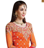 Shaded orange and pink bottom in santoon. Decorated with same zari, resham and stone work. Embraced with shaded orange and pink chiffon dupatta Photo