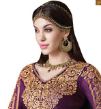 Purple colored art silk straight salwaar kameez karachi style style and comfort best describe this dress for today's women.featuring art silk kameez in purple and georgette sleeves Photo