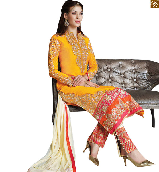 Yellow jacket style straigh salwaar kameez make a new style statement, every time you wear this yellow cream dress. Yellow cream art silk kameez Pic
