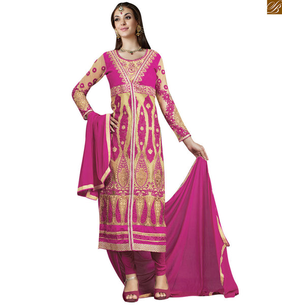 Pink colored art silk straight karachi style salwaar kameez this pink dress is perfect choice for any occasion. Cream and pink art silk and net kameez, experimented with ethnic design of butas Image
